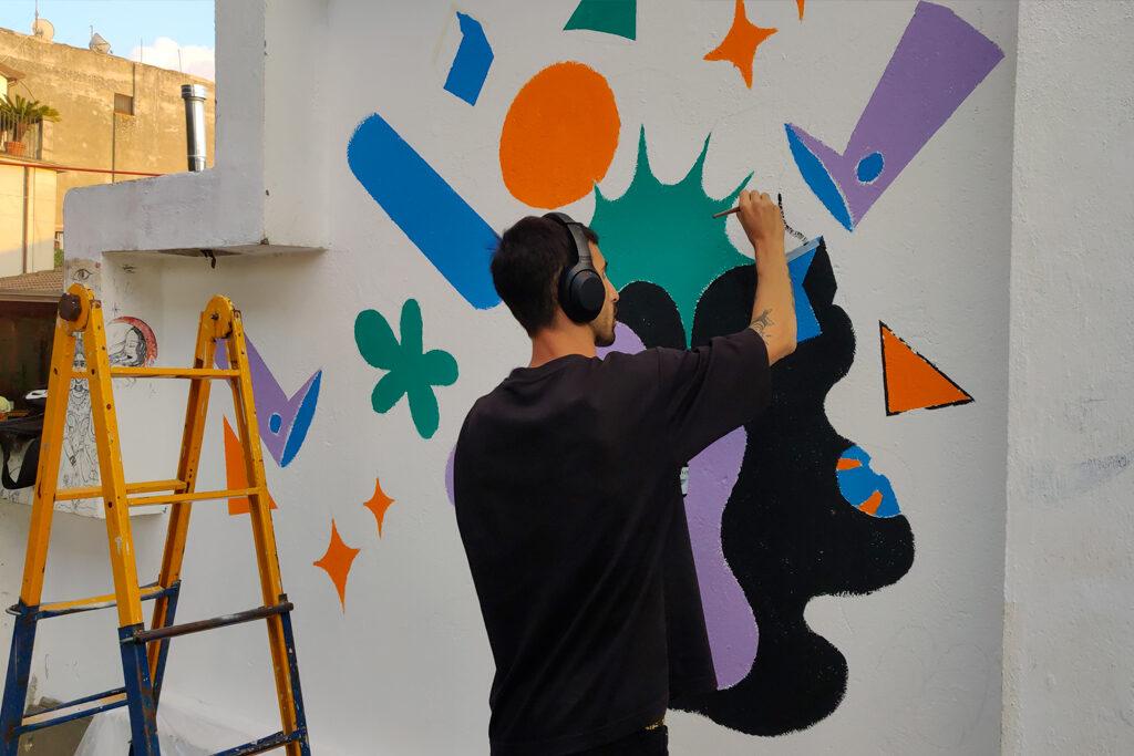 """Murales """"SMILE"""" parete dell'ex mercato del pesce di Taurianova - Federico Manuli - Musica Sottolio XV Edizione"""